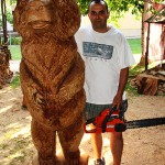 Woodcarver Vinko with wooden bear made through chain saw woodcarving