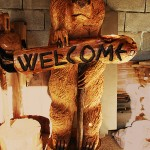 Bear wooden sculpture - chainsaw wood carving (welcome sign)