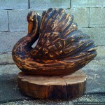 Black swan (left side) - chainsaw wood carving