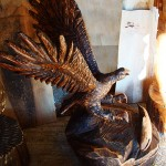 Hawk sculpture made through chainsaw woodcarving