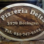 Pizzeria Delta - company logo (wood carving)