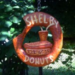 Shelby Donuts - company logo made through woodcarving