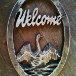 Welcome sign with swan - wood carving