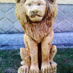 White lion (front) - chainsaw wood carving
