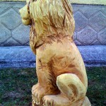 White lion (left side) - chainsaw wood carving
