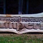 Motel restaurant Imperial - company logo carving