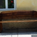 Wood bench with bears made through chainsaw carving