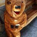 Bear as part of wood bench (side) - chainsaw carving