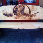 Wooden bench with bear made thru chainsaw carving