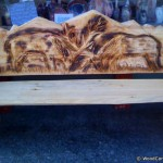 Wooden bench with deers made through chainsaw carving